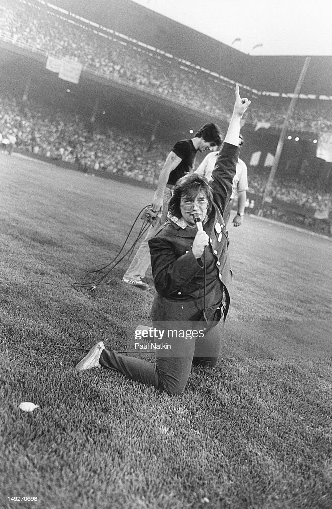 American disc jockey Steve Dahl kneels on the field as he leads the crowd in chants during an antidisco promotion at Comiskey Park Chicago Illinois...