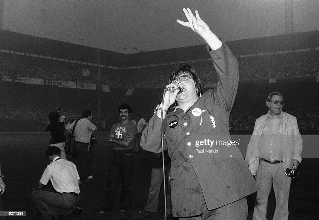 American disc jockey Steve Dahl leads the crowd in chants during an antidisco promotion at Comiskey Park Chicago Illinois July 12 1979 The event...