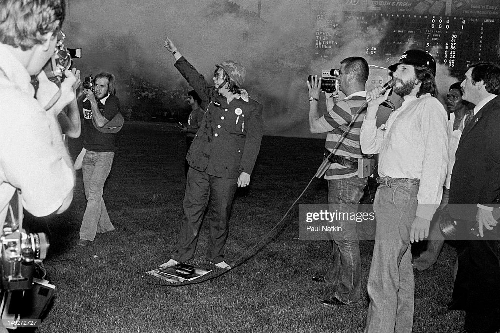 American disc jockey Steve Dahl waves to the crowd during an antidisco promotion at Comiskey Park Chicago Illinois July 12 1979 The event hosted by...