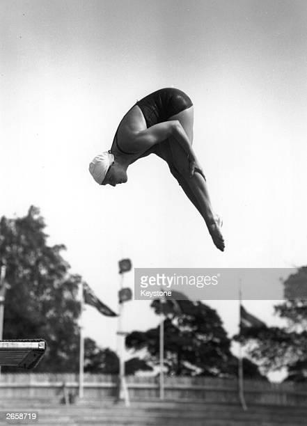 American diver Pat McCormick in action during the final of the Olympic Springboard event in Helsinki Finland She won gold in both this event and the...
