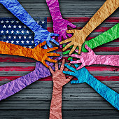 American diversity holding as diverse hands made of crumpled paper connected together as a concept for citizen solidarity and patriotic friendship in the united states,