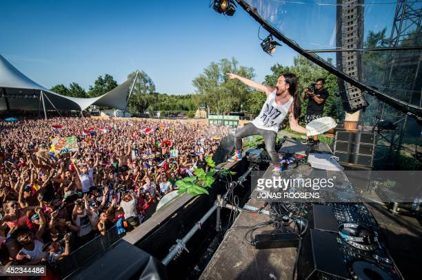 American DJ Steve Aoki throws a cream tart into the crowd during the first day of the Tomorrowland music festival in Boom on July 18 2014 The 10th...