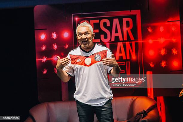 American dog trainer and television presenter Cesar Millan performs live on stage wearing a jersey of the German national soccer team during his show...