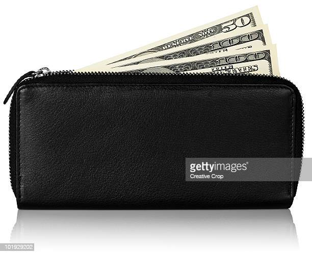 American dollar bills in leather purse / wallet
