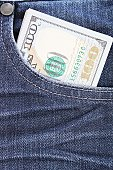 Business, finance, investment, loan, saving or shopping concept : American Dollars cash money in the pocket of blue jeans