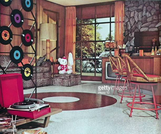 American domestic interior showing portable Vinyl Record player and discs USA 1965
