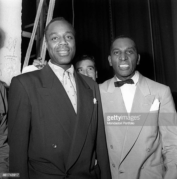 American drummer Cozy Cole on the right posing beside another musician of the band of American trumpeter and singer Louis Armstrong at Malpensa...