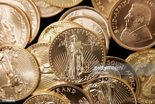American Eagle and South African Krugerrand gold bullion is offered for sale at the Chicago Coin Company May 11 2006 in Chicago Illinois Inflationary...