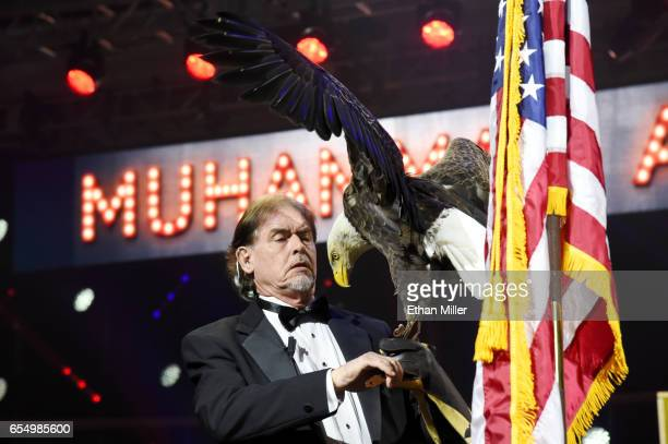 American Eagle Foundation Founder and President Al Louis Cecere prepares to fly a bald eagle named Challenger during a rehearsal for Muhammad Ali's...