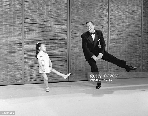 American entertainer Gene Kelly dances with Cherylene Lee on a television special called 'The Gene Kelly Pontiac Special' April 24 1959 Kelly is...