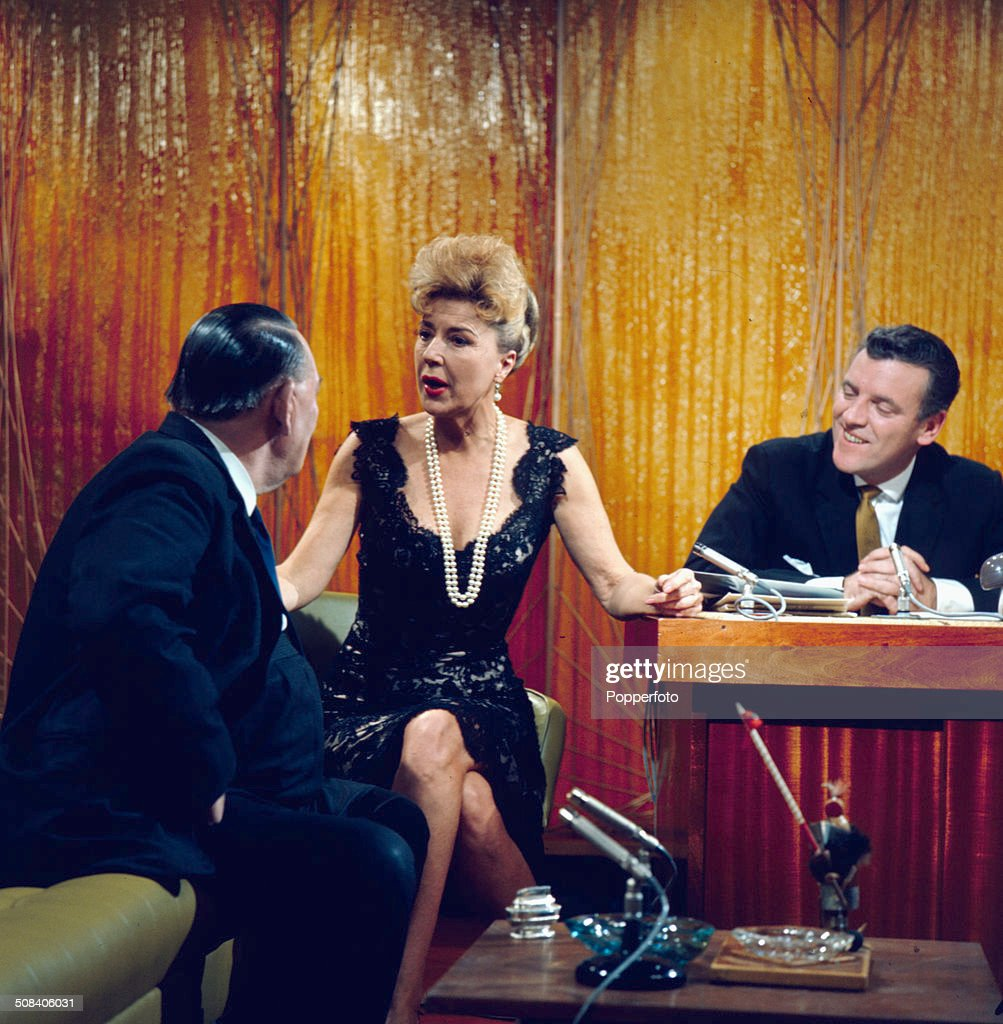 American entertainer <a gi-track='captionPersonalityLinkClicked' href=/galleries/search?phrase=Gypsy+Rose+Lee&family=editorial&specificpeople=215427 ng-click='$event.stopPropagation()'>Gypsy Rose Lee</a> (1911-1970) appears with trade unionist Ted Hill (1899-1969) and chat show host Eamonn Andrews (1922-1987) on the set of the television series 'The Eamonn Andrews Programme' in 1965.