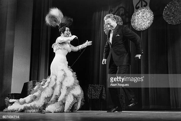 American entertainer Josephine Baker and French singer Charles Trenet perform a duet at Paris' Olympia Hall