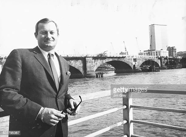 American entrepreneur Robert P McCaulloch standing in front of London Bridge as it is dismantled ready for transportation back to America London...