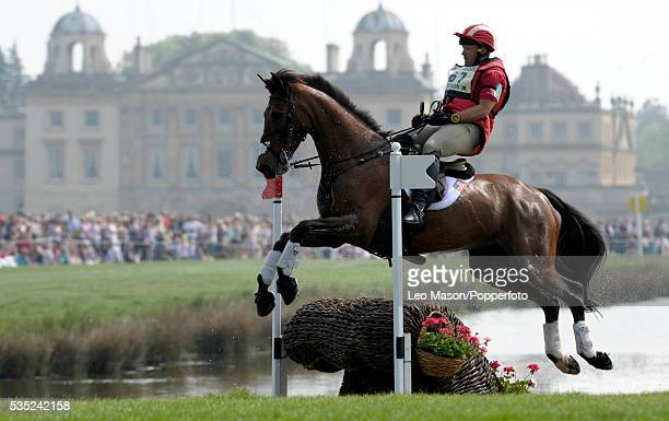 American equestrian Bruce Davidson riding Ballynoff Castle exits the lake complex with Badminton House in the background during competition in the...