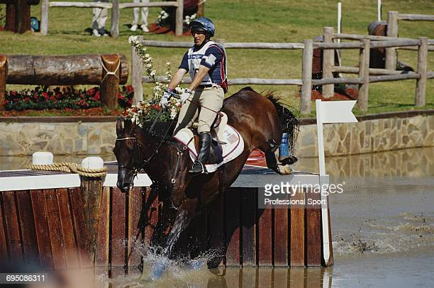 American equestrian David O'Connor competes on Giltedge for the United States team to finish in third place to win the bronze medal in the Team...