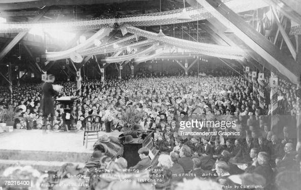 American evangelical preacher Billy Sunday delivers a sermon to some 6000 attendees at a revival meeting Bloomington Illinois late 1907 or early 1908...