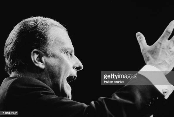 American evangelist Billy Graham addresses the congregation at the opening of the 32day Greater London Crusade at the Earls Court Convention Centre...