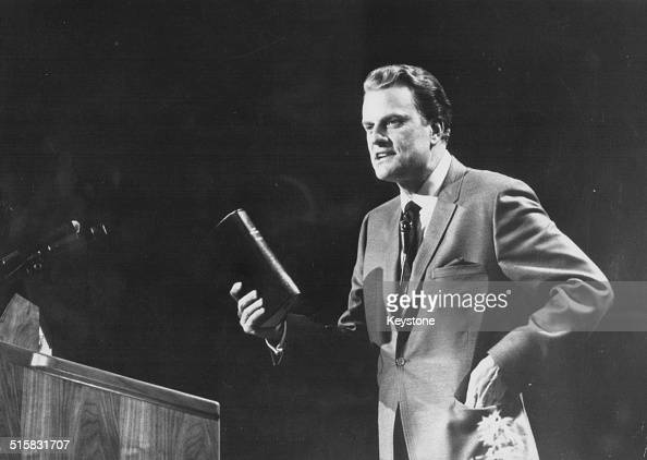 American evangelist Billy Graham giving a speech on stage circa 1970