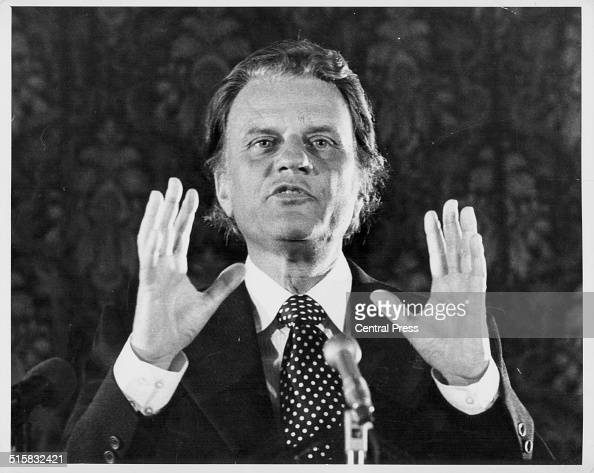 American evangelist Billy Graham talking into a microphone at a press conference Connaught Rooms London August 23rd 1973
