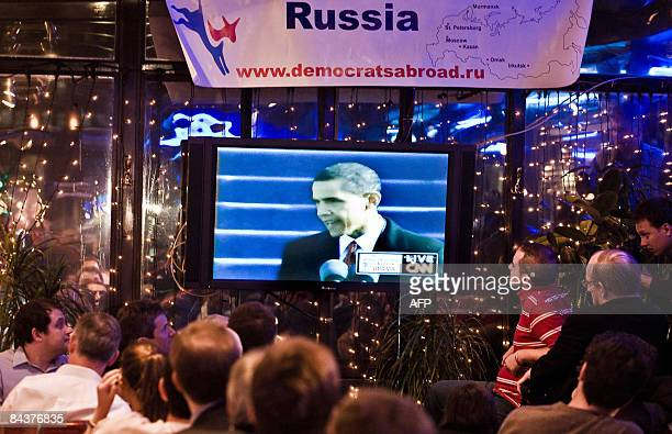 American expatriates and Russians watch the inauguration of US President Barack Obama televised live and shown on big screens at an Americanstyle...