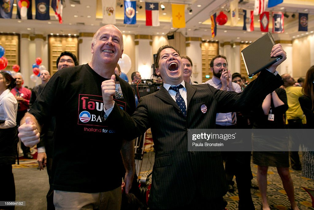 American expats react as President Barak Obama wins his re-election bid at the U.S embassy election watch party November 7, 2012 in Bangkok, Thailand. Obama won with 303 electoral votes to Romney's 206 with Florida votes still not included in the total.