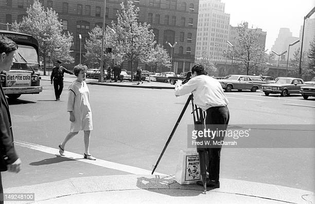 American experimental filmmaker Ken Jacobs films a woman New York New York May 29 1966 The view is looking south and the area was later made into the...
