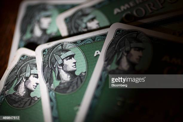 American Express Co corporate credit cards are arranged for a photograph in Washington DC US on Wednesday April 15 2015 American Express which is...