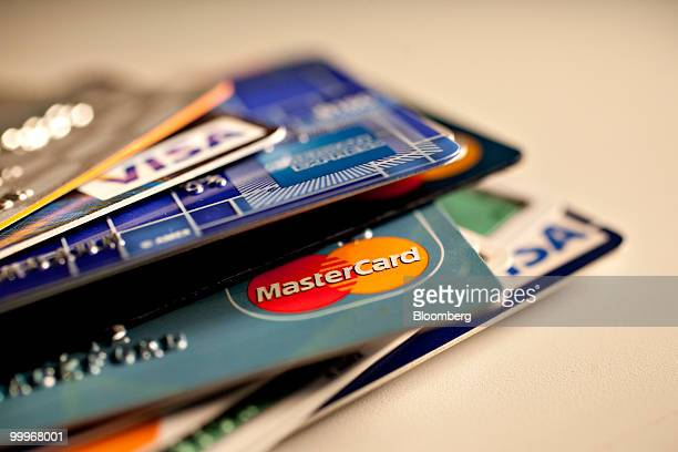American Express MasterCard and Visa credit cards are displayed for a photograph in New York US on Tuesday May 18 2010 Creditcard firms caught...