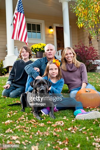 american family in front of house with happy smiles stock photo getty images. Black Bedroom Furniture Sets. Home Design Ideas