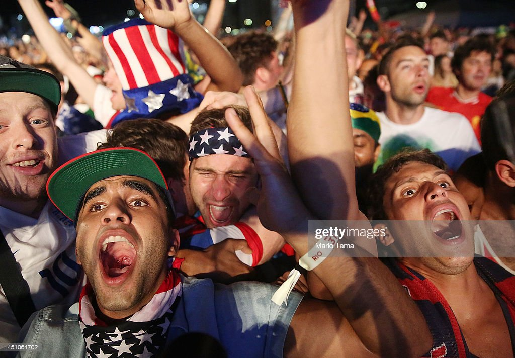 American fans celebrate after the U.S. scored to take a 2-1 lead over Portugal while watching a video broadcast at the FIFA Fan Fest on Copacabana Beach during the 2014 FIFA World Cup Brazil on June 22, 2014 in Rio de Janeiro, Brazil. The game ended in a 2-2 tie.