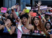 American fans of Korean Kpop group Girl's Generation scream as they appear on the red carpet during the KCON 2014 at the Los Angeles Memorial Sports...