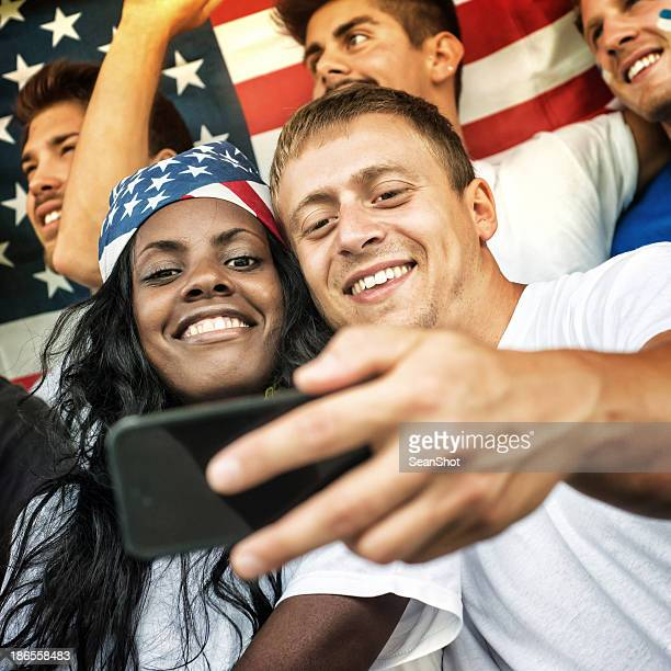 American Fans Taking a Photo with Mobile Phone