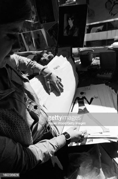 American fashion designer Betsey Johnson looks through a pile of sketches in her studio New York New York September 6 1966
