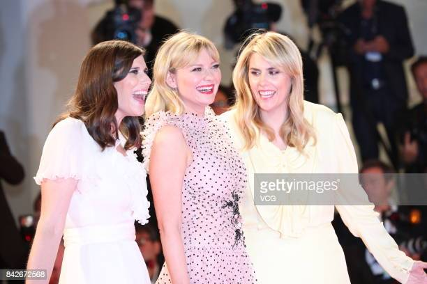 American fashion designer Laura Mulleavy American actress Kirsten Dunst and American fashion designer Kate Mulleavy arrive at the red carpet of film...
