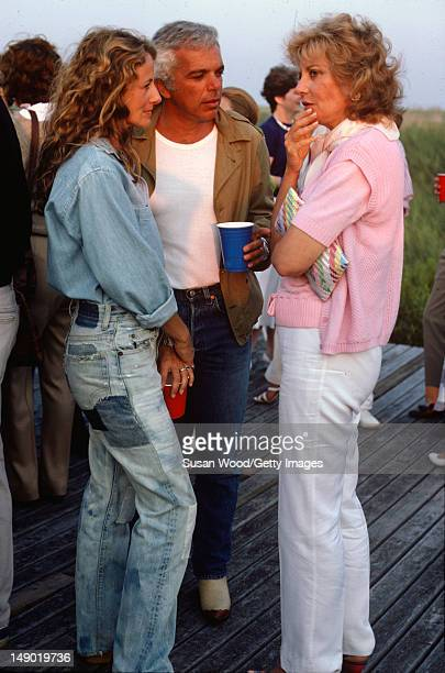 American fashion designer Ralph Lauren and his wife therapist Ricky Lauren speak with television journalist Barbara Walters at an outdoor party on a...