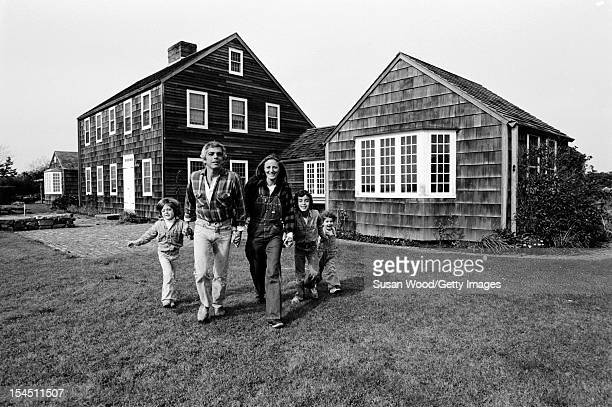 American fashion designer Ralph Lauren and his wife therapist Ricky Lauren walk outside their home with their children David Andrew Dylan East...