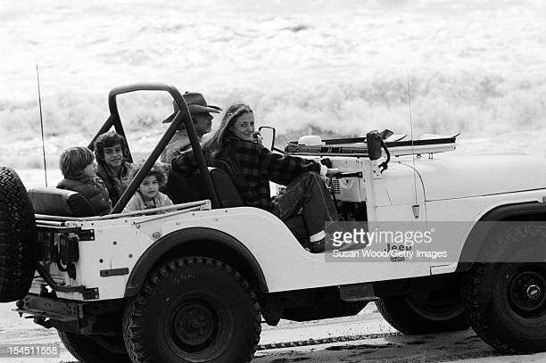 American fashion designer Ralph Lauren and his wife therapist Ricky Lauren sit in a jeep on the beach with their children David Andrew Dylan East...