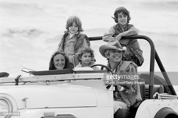 American fashion designer Ralph Lauren and his wife therapist Ricky Lauren drive in a jeep on the beach with their children David Andrew Dylan East...