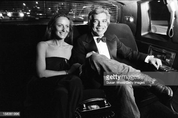 American fashion designer Ralph Lauren and his wife therapist Ricky Lauren smile in the backseat of a limosine New York November 1977 The pair were...