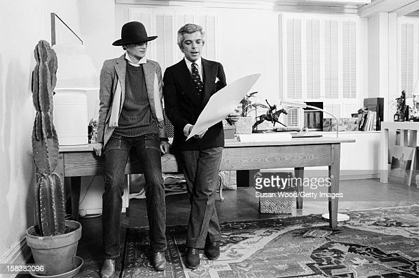 American fashion designer Ralph Lauren looks at drawings with an unidentified woman in his 7th Avenue office New York New York November 1977