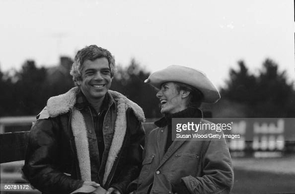 American fashion designer Ralph Lauren smiles outdoors with his wife Ricky 1970s