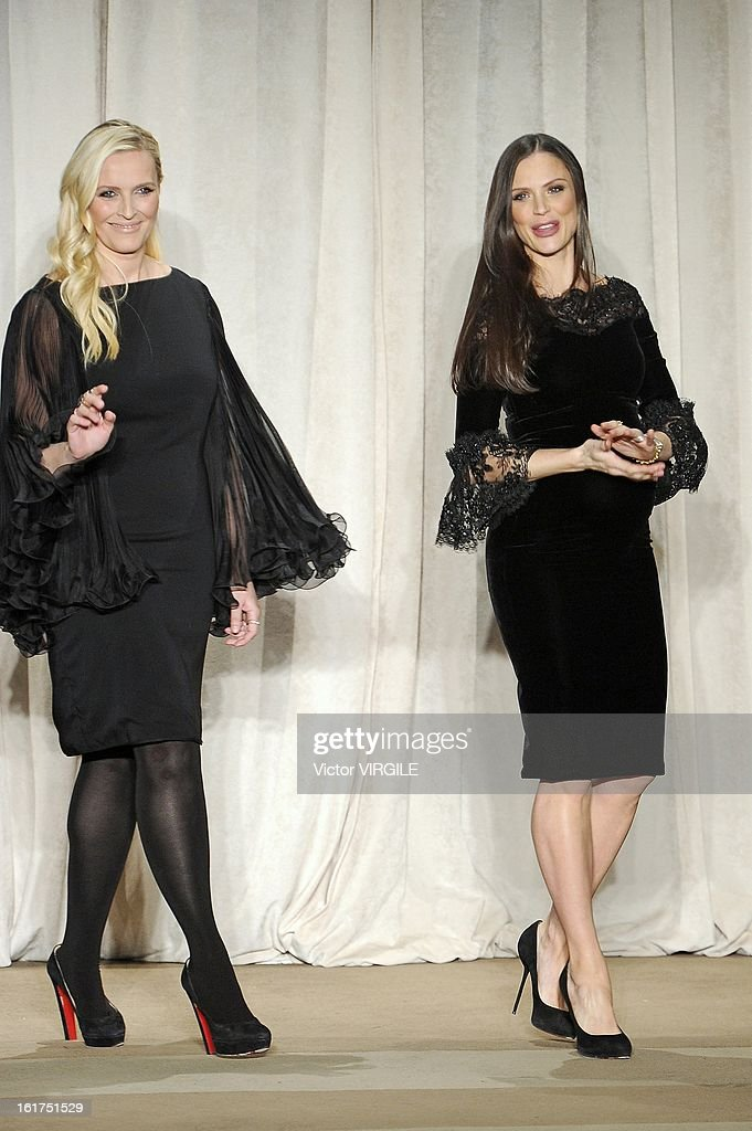 American fashion designers Keren Craig and Georgina Chapman walk the runway at the Marchesa Ready to Wear Fall/Winter 2013-2014 fashion show during Mercedes-Benz Fashion Week at The New York Public Library on February 13, 2013 in New York City.