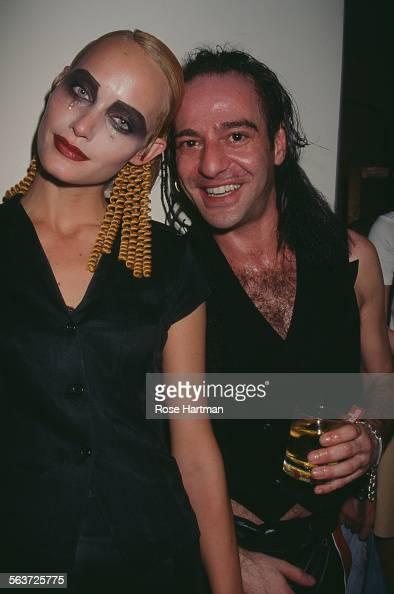 American fashion model Amber Valletta and British fashion designer John Galliano at the Galliano fashion show circa 1995