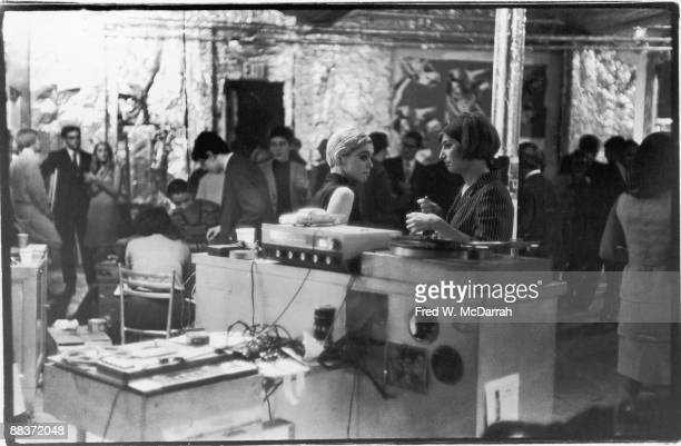 American fashion model and actress Edie Sedgwick stands with an unidentified woman near the dj 'booth' during a party in pop artist Andy Warhol's...