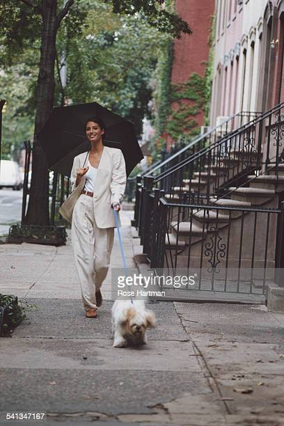 American fashion model Christy Turlington wearing Michael Kors for a fashion shoot on Charles Street New York City 1992