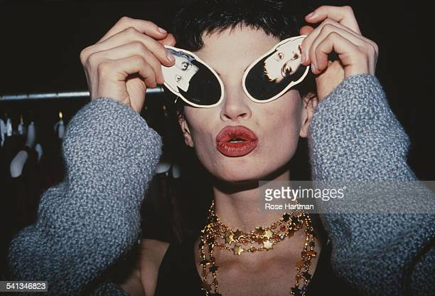 American fashion model Kristen McMenamy backstage after an Isaac Mizrahi fashion show 1992