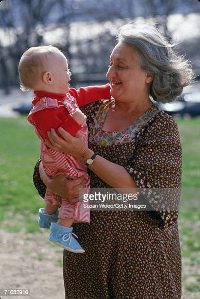 American feminist author and social activist Betty Friedan holds her grandson Raphael New York April 1983