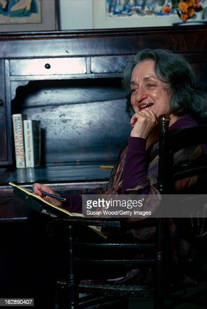 American feminist author and social activist Betty Friedan sits at a table in her home Sag Harbor New York 1978