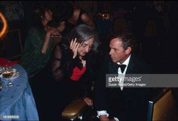 American feminist author and social activist Betty Friedan speaks to an unidentified man at a fund raiser for the Blueberry Treatment Center at the...