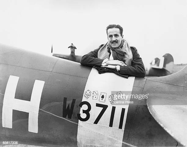 American fighter pilot Richard Fuller Patterson leans on the tail section of his Spitfire aircraft 28th November 1941 Patterson is a member of the...